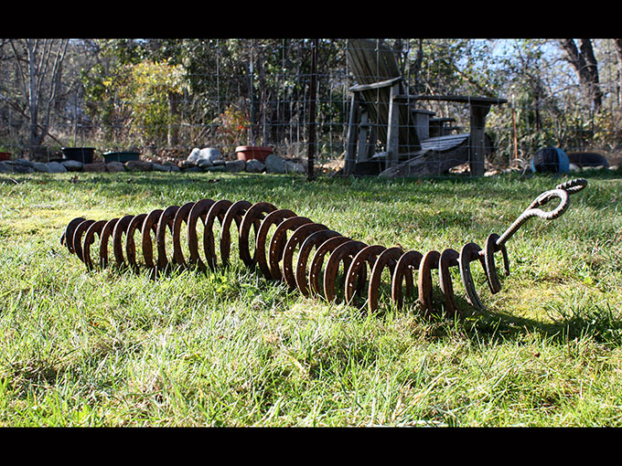 caterpillar metalwork rusty metal horse shoe art sculpture welding jeremy criswell jacksonville oregon public art
